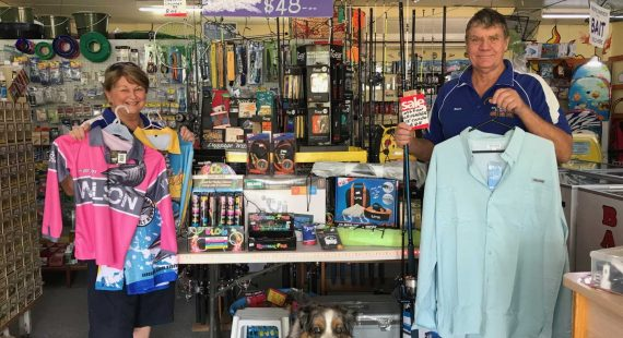 terri and Bruce from Rainbow Beach Hardware, Fishing and Camping show off some of their Christmas Specials