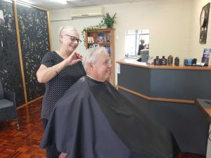 Barber Chris Challenor gives Trevor Booth a trendy trim