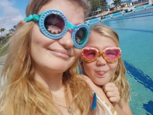 """Suitable for all ages, Cyndari and Jahli model """"Blue Chill"""" and """"Gelato Girl Baby Pink"""" Bling2O goggles, available now at the Rainbow Beach pool. (Plus a big happy birthday to Cyndari who turned 18 last month!)"""