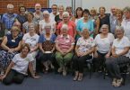 Tin Can Bay Camera Club members celebrate winning the Tewantin-Noosa Shield