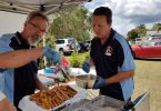 Tin Can Bay Fishing Club members, Harry Duncan and Paul Morehouse, cook up a feast of fish Image Jess Milne