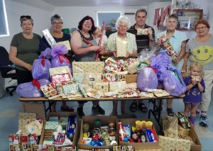 The QCWA team proudly display the gifts, groceries and food destine for drought affected families for Christmas