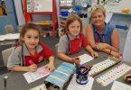 Chappy Karen helping Alyssa Latimore Eliza O'Driscoll find a word at Tin Can Bay School