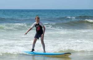 Riley's first lesson - you can learn too with a kids' Surf School in January