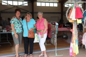 Kim Cozens, Glenda Eckle and Lyn Barrett catch up at the Craft Vintage and Recyclables Fair at the Rainbow Beach Hall