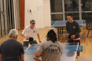 Youngsters James and Alex vs older residents, Peter and Daniel: all ages are welcome at table tennis