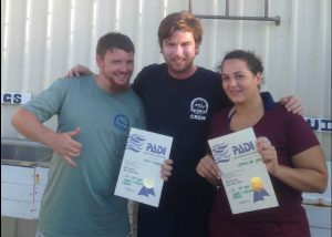 James from Wolf Rock Dive (centre) congratulates Scott Higham and Crystal-Lee Lewis who completed the PADI Open Water Course with Wolf Rock Dive - they invite more locals to qualify with them