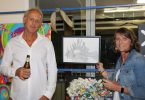 Grant and Kathy McFarlane with Kathy's ARTYball sketch of Grant's Lionfish