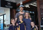 "Brent and Alex with kids, Ruby, Max and Henry, outside their new business ""Brent's Burgers"""
