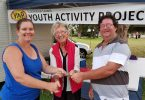 Chris and Glenys from Colbridge Amusements present YAP President Jess Milne with $500