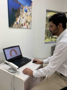 Dr Abhi Sharma, from Cooloola Cove Smiles at Tin Can Bay - designing a crown on the three-dimensional scan
