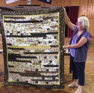 June Fraser shows off her quilt - join the Tin Can Bay Quilters on Tuesdays