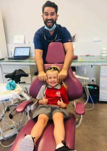 It is all smiles for Dentist Joel Pavy and Izzy Antrobus because eligible families receive free dental with NO GAP!
