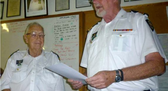 Commander John Macfarlane presented a certificate of appreciation to Brian Morris please lighten - remove person in the background if possible