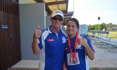 U12 Anjelica Geurts with Coach Bill give her silver medal win a thumbs up