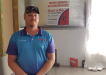 Ben Andrews of Beach to Bay Pest Management proudly standing in front of the workbench his company sponsored