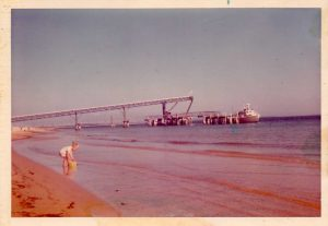 Ian Dean - Mineral sand jetty on Fraser island with a young Tony Dean in the foreground – 1974