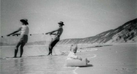 Net fishing on the beach with a young Tony Dean in the foreground – 1960's