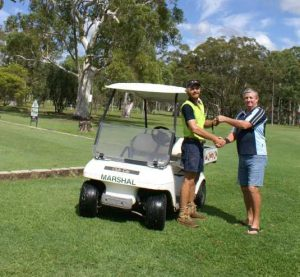 Dustin Carne, the new greenkeeper at Tin Can Bay Country Club, is welcomed by Mick Hall, who retired from the role after 25 years service
