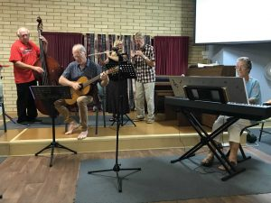 Frank on Bass Gunther on guitar Debbie on flute Len on treble recorder and Pam on piano