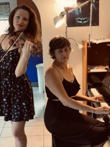 Violinist is Helen Brereton and the Pianist is Irina Prodger