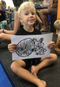 Kasey-Cruze shows off his artwork