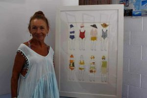 Yvonne Connelly with 'The Walking Lady', the highly prized piece found a home at Rainbow Getaway Holiday Apartments