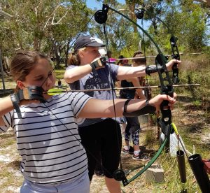 The O'Neil sisters from Brisbane try their hand at archery from last YAP activity day