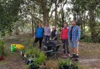 L-R Jess Milne (Weed Warriors Team Leader), Linda Tabe (Vice President), Julie Venn, Ferne Tabe, and Rod Hutchinson preparing the tools and plants ready for planting by Ben Galea