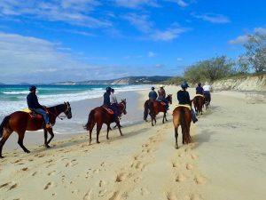 Winter beach riding with Rainbow Beach Horse Rides.