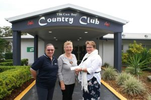 Julie Thorne and Julie Collins from TCB Meals on Wheels with TCB Country Club Treasurer Janet Reibel and a donations for $1000