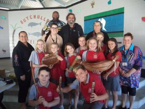 NAIDOC Day Photo Attached – Community Elders with some of the students learning about the bush tucker and artifacts.