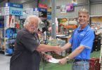 Mark Denham from Mitre 10 presenting Bryan Phillips with a cheque for bench sponsorship