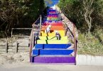 The Rainbow Beach stairs as they are today with some helpful 'extras' who were happy to be in the photo - Photo Courtesy of Garry Hewitt