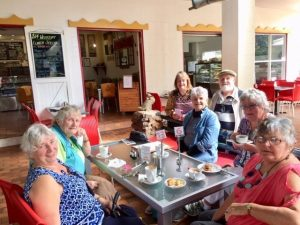 Cherryl Mossman, Jo Said, Marie Parker, Jan Murfett, Joan Barnier, and in the back Robert and Jeanette Murray enjoying lunch at Mary Cairncross Park with Probus