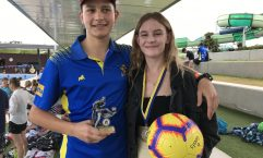 Rainbow Beach residents Archie Gilmore with his Player's Player trophy for Under 14 Men and Abbey-Rose Cairns who won the Golden Boot prize for most goals on her team at the Gympie United Football Club Presentation