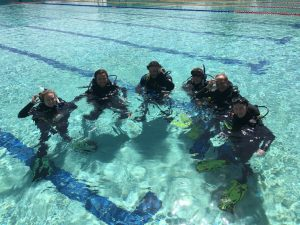 Discover Scuba Divers trying diving for the first time at Rainbow Beach Pool before they headed to Round Rock, the 'nursery' dive site