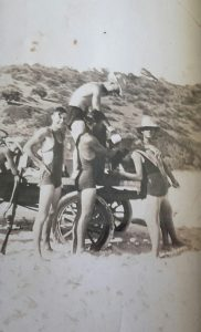 """Henry """"Chookie"""" Mallet with his truck and friends. Walter Mallet, Jack Dun, Henry Mallet washing Ruby Compton's hair, Bill Ross at Double Island"""