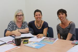 The new Rainbow Beach Community Centre committee are Secretary Rose Mayes, on the left, President Elisa Saul, centre, and Treasurer Kirstie Jordison, on the right