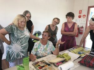 "Photo: Members being given the ""how to"" of watercolour L-R: Rae Donnell, Susan Riddett, Lee Bubb, Kay Muir, Lies Donovan and artist Mary Argall, centre"