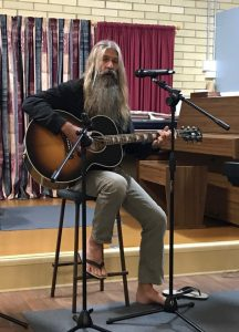 One of our performers Rob, who uses his love of playing the guitar to raise money for the Youth Activity Project. You can often hear him at the markets, in restaurants and at our musical evenings.
