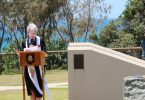 Reverend Ingrid Busk offering prayers at the 2019 Remembrance Day Service in Rainbow Beach