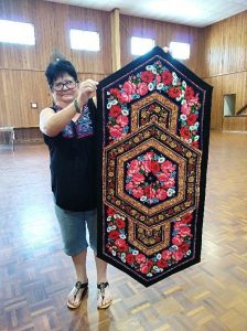 Leonie from the Tin Can Bay Quilting Club with her dazzling table runner
