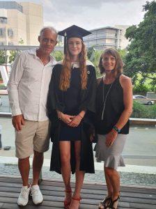 Rachel with her parents, Grant and Kathy McFarlane, at Rachel's recent graduation