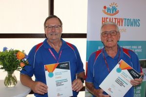 CCMT Secretary Kevin Somerville and President Neil Goodyer accepting the Healthy Towns CCMT Award - what a great win - congratulations!