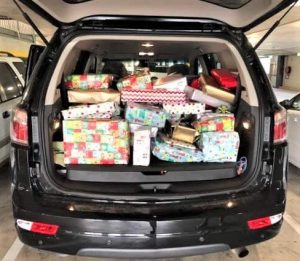 The back of the Manager Brad Robb's car packed full of presents on their way to Community Action