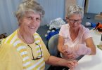 Katrina from QCWA practices bandaging techniques on YAP volunteer Julie