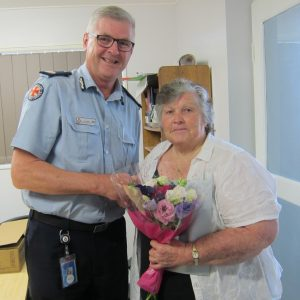 Lillian Clark being presented with her 40 years of service medal by Acting Assistant Commissioner, Ian Tar