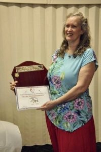 Margie receiving the trophy for Biggest Bream on behalf of her late husband, Mark Wotherspoon. Mark was a very much loved and respected member of the TCBFC who passed away suddenly last year