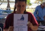 Ella Beauchamp with her Certificate of Achievement from Sailability at Tin Can Bay